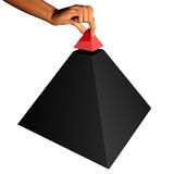 Finishing a pyramid Royalty Free Stock Image