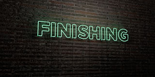 FINISHING -Realistic Neon Sign on Brick Wall background - 3D rendered royalty free stock image Royalty Free Stock Photos