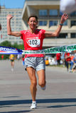 Finishing run woman Stock Image
