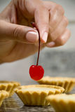 Finishing touch with cherry Royalty Free Stock Photos