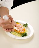 Finishing touch on cold meats stock images