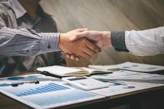 Finishing up a conversation after collaboration, handshake of two business people after contract agreement to become a partner,. Collaborative teamwork royalty free stock photos