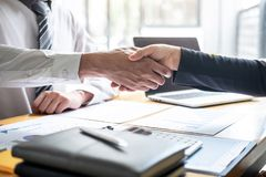 Finishing up a conversation after collaboration, handshake of two business people after contract agreement to become a partner, royalty free stock photos