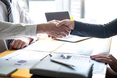 Finishing up a conversation after collaboration, handshake of two business people after contract agreement to become a partner, stock photos
