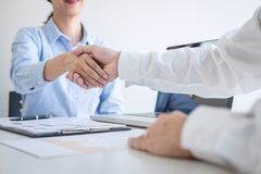 Finishing up a meeting, Business handshake after discussing good deal of Trading to sign agreement and become a business partner, royalty free stock image