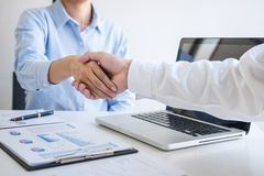 Finishing up a meeting, Business handshake after discussing good deal of Trading to sign agreement and become a business partner, stock images