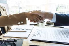 Finishing up a meeting, handshake of two happy business people a royalty free stock image