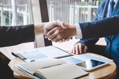 Finishing up a meeting, handshake of two happy business people after contract agreement to become a partner, collaborative royalty free stock image