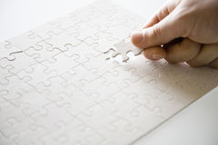 Finishing white puzzle Royalty Free Stock Image