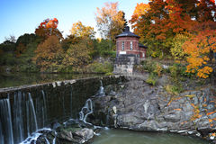 Finland: Autumn in Helsinki. Waterfall and stream of water flowing to the old town bay in Helsinki in Vanhankaupungin koski royalty free stock image