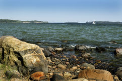 Finland, Baltic sea coast, sailboat on the horizon Stock Photography