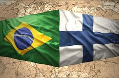 Finland and Brazil. Waving Finnish and Brazilian flags of the political map of the world Stock Images