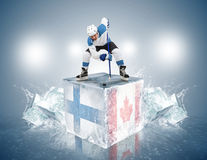 Finland - Canada game. Face-off player on the ice stock photo