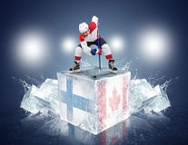 Finland - Canada game. Face-off player on the ice cube. Stock Image