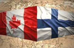 Finland and Canada. Waving Finnish and Canadian flags of the political map of the world Stock Photo