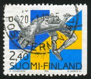 High Jumper Patrick Sjoberg. FINLAND - CIRCA 1994: stamp printed by Finland, shows High Jumper Patrick Sjoberg, circa 1994 Royalty Free Stock Image