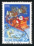 Santa. FINLAND - CIRCA 1991: stamp printed by Finland, shows Reindeer pulling Santa sleigh, circa 1991 stock image