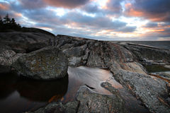 Finland: Coast of the Baltic Sea. Rocky shoreline in an island and stormy Baltic Sea in autumn Stock Image