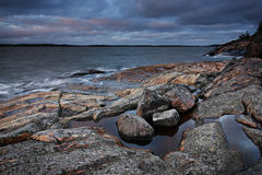 Finland: Coast of the Baltic Sea. Rocky shoreline in an island and stormy Baltic Sea in autumn Royalty Free Stock Image