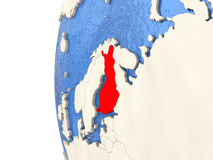 Finland on 3D globe. Map of Finland on globe with watery blue oceans and landmass with visible country borders. 3D illustration Royalty Free Stock Photo