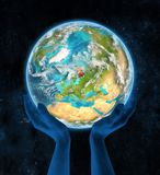 Finland on planet Earth in hands. Finland on Earth in hands in space. 3D illustration Royalty Free Stock Image