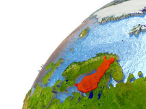 Finland on Earth. Finland highlighted in red with surrounding region. 3D illustration with highly detailed realistic planet surface and reflective ocean waters Royalty Free Stock Images