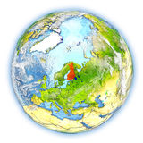 Finland on Earth isolated. Finland highlighted in red on planet Earth. 3D illustration isolated on white background. Elements of this image furnished by NASA Stock Photography