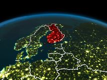 Finland on Earth at night. Space orbit view of Finland highlighted in red on planet Earth at night with visible country borders and city lights. 3D illustration Stock Photography