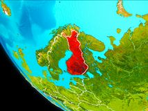 Finland on Earth from space. Finland highlighted in red on planet Earth with visible borders. 3D illustration. Elements of this image furnished by NASA Royalty Free Stock Photos