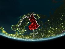 Finland on Earth from space at night. Finland highlighted in red on planet Earth at night with visible borders and city lights. 3D illustration. Elements of this Royalty Free Stock Photography