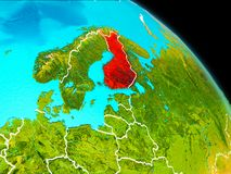Finland on Earth. Space orbit view of Finland highlighted in red on planet Earth with visible borders. 3D illustration. Elements of this image furnished by NASA Royalty Free Stock Photo
