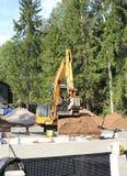 Finland:Sauna Constr. - Excavator Emptying Bucket Royalty Free Stock Image
