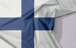 Finland fabric flag crepe and crease with white space. Finland fabric flag crepe and crease with white space, Sea blue Nordic cross on a white field stock photo