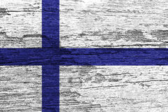Finland Flag. Painted on old wood plank background royalty free stock images