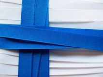 Finland flag or banner. Made with white and red ribbons royalty free stock images