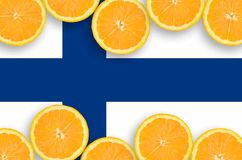 Finland flag in citrus fruit slices horizontal frame. Finland flag in horizontal frame of orange citrus fruit slices. Concept of growing as well as import and royalty free stock images