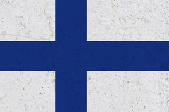 Finland flag on concrete wall. Patriotic grunge background. National flag of Finland royalty free stock images