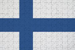 Finland flag is depicted on a folded puzzle stock illustration