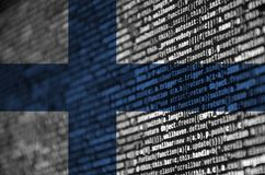 Finland flag is depicted on the screen with the program code. The concept of modern technology and site development.  stock illustration
