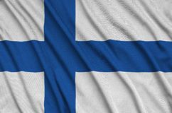 Finland flag is depicted on a sports cloth fabric with many folds. Sport team banner. Finland flag is depicted on a sports cloth fabric with many folds. Sport royalty free stock photography