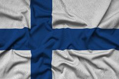 Finland flag is depicted on a sports cloth fabric with many folds. Sport team banner. Finland flag is depicted on a sports cloth fabric with many folds. Sport royalty free stock image