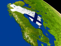 Finland with flag on Earth Stock Image