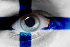 Beautiful Finland flag on mans face. Finland flag on mans face stock image