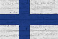Finland flag painted on old wood plank. Patriotic background. National flag of Finland royalty free stock image