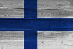 Finland flag painted on old wood plank. Patriotic background. National flag of Finland stock photos