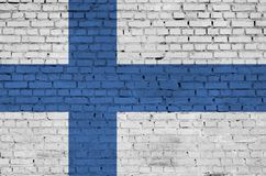 Finland flag is painted onto an old brick wall royalty free stock photo