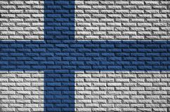 Finland flag is painted onto an old brick wall stock photos