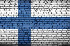 Finland flag is painted onto an old brick wall stock illustration