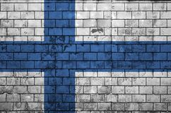 Finland flag is painted onto an old brick wall stock photo