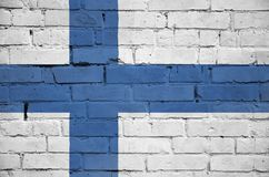 Finland flag is painted onto an old brick wall royalty free stock images